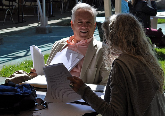 Ron Carlson consults with an attendee during the 2010 Napa Valley Writers' Conference